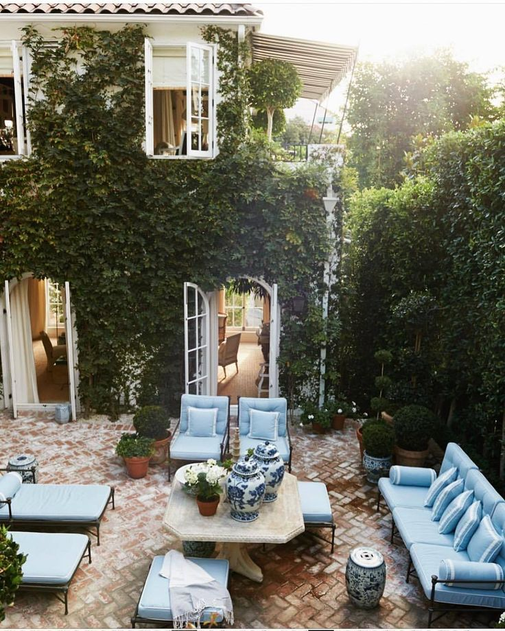 Beautiful courtyard garden enclosed on all sides by vine-covered walls Los Angel...