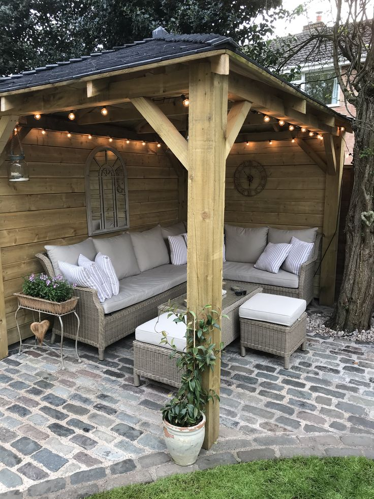 Homemade wooden gazebo, cobbles, garden lights, outdoor sofa, outdoor seating, a...