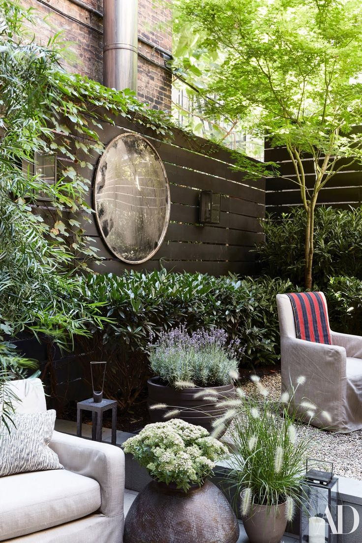 In the garden, designed by Harrison Green, custom armchairs by August Studios we...