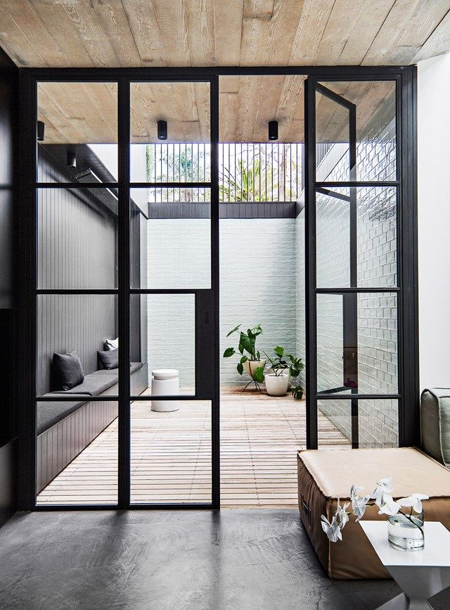 Internal courtyards flood narrow homes with natural sunlight while the surroundi...