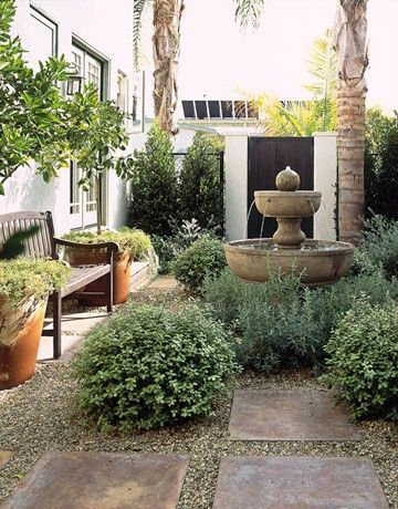 courtyard feel for cottage side garden?....large pavers with gravel in between a...