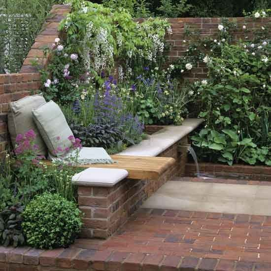 Love this bench with overhang set into the flowerbed!