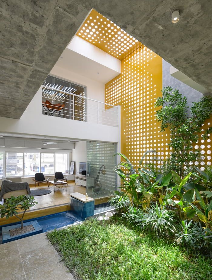 Double height living spaces around the central indoor courtyard garden and pond ...