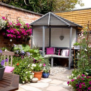 Courtyard Garden with Corner Arbour | Ideal Home