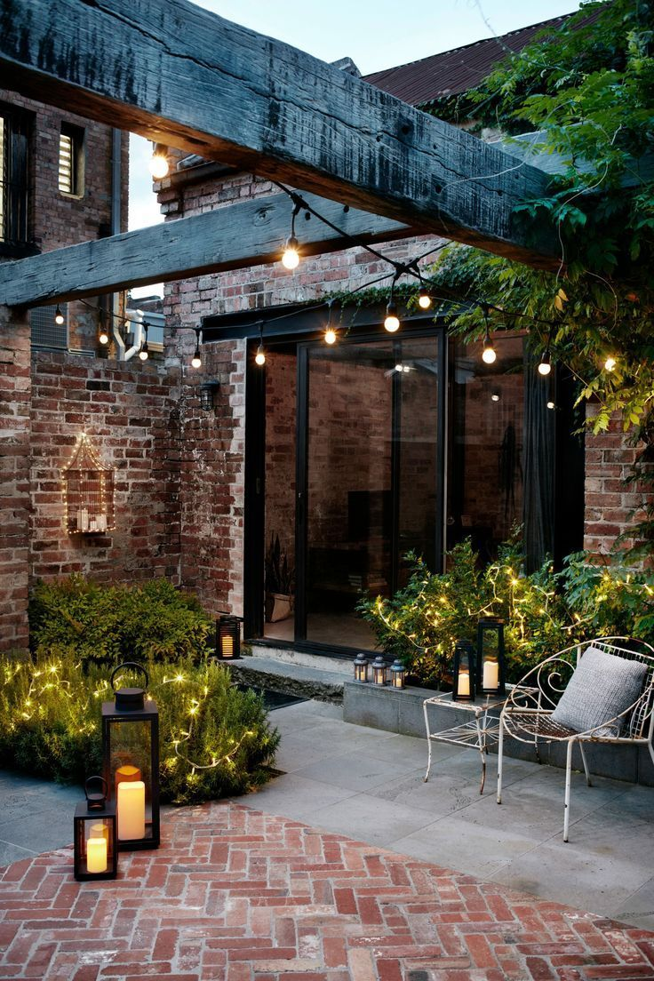 Courtyard gardens are perfectly matched with garden lanterns and festoon lights,  #Courtyard ...
