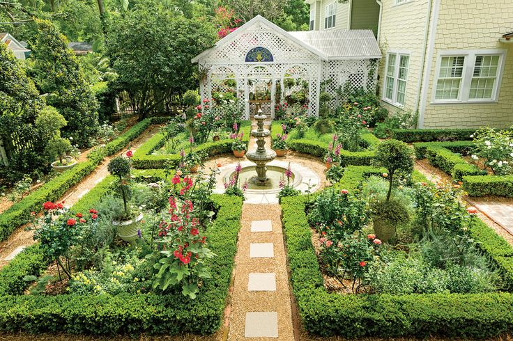 Once a pool, this peaceful English courtyard garden is filled with roses, holl...