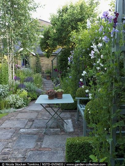 By screening the boundaries with lush planting, you make the garden seem far big...