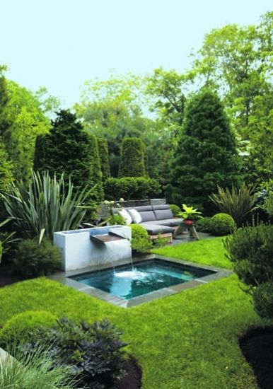Tucked behind an inviting plunge pool and fountain, the garden's patio feature...