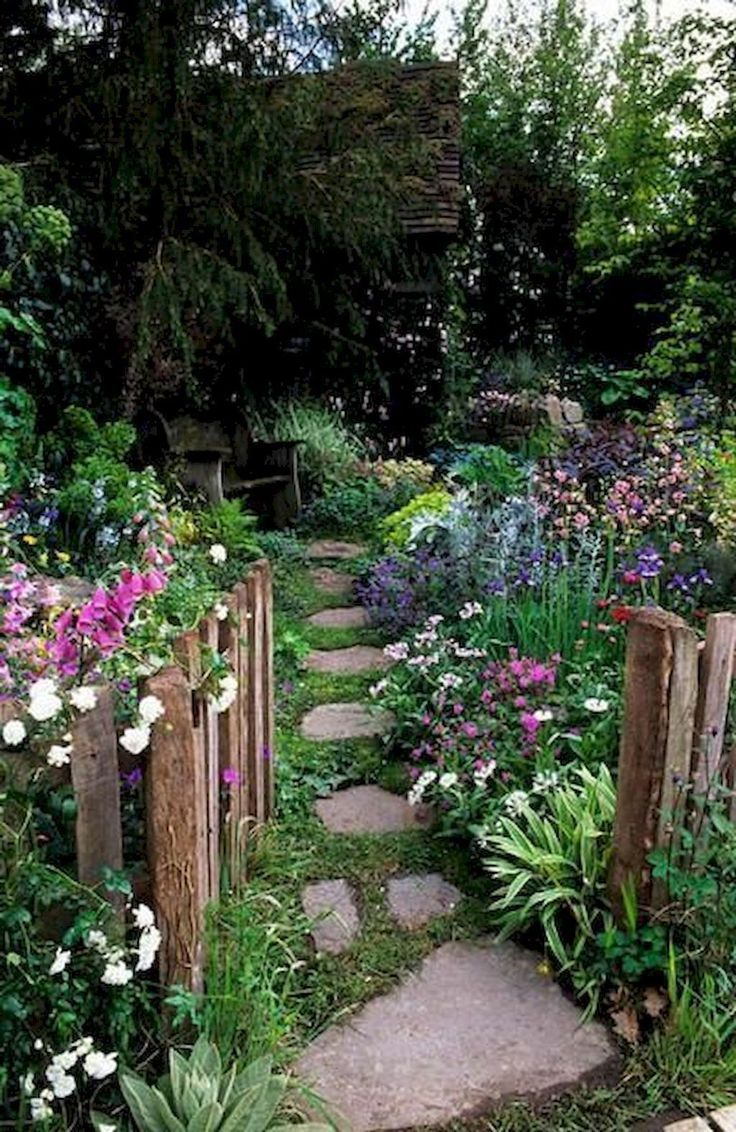 Stunning garden with beautiful rustic fence leading into a quiet sanctuary