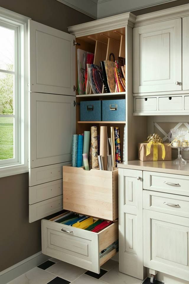 The perfect storage closet for a home gift wrapping station www.CabinetsAndDe...