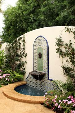 The term 'courtyard garden' conjures up visions of stately containers. T...