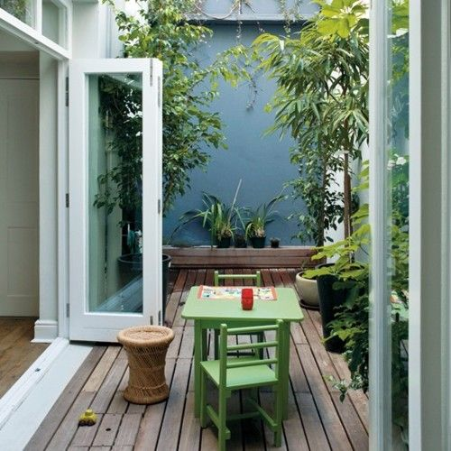 green-home: I think painting a tiny courtyard garden wall, in a strong colour is...