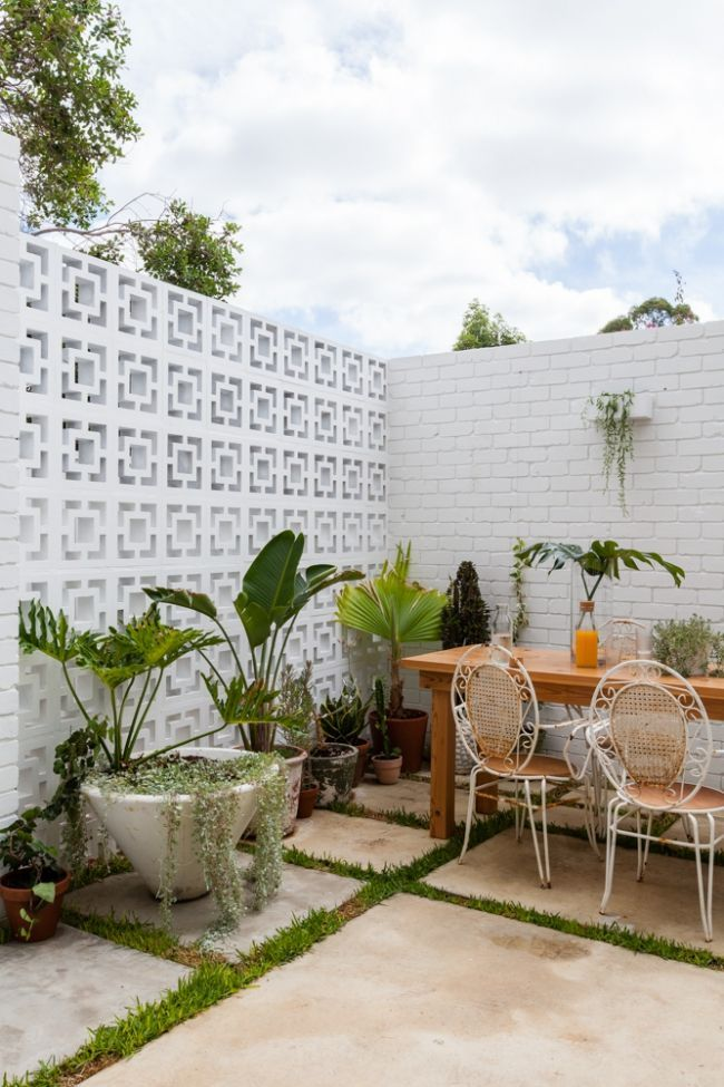 Breezeblocks add a feature wall to this small courtyard garden. The Nature Inspi...