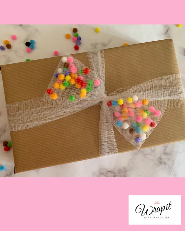 Tulle bow filled with mini pom poms, fun, colourful gift wrap for birthdays.