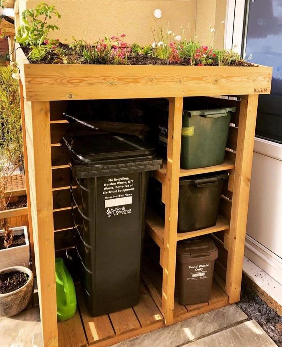 Garbage can and recycling business with green roof planter